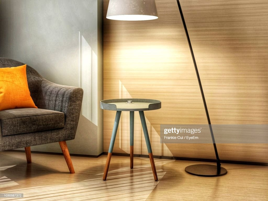 Illuminated Floor Lamp By Table In Modern Home : Foto de stock