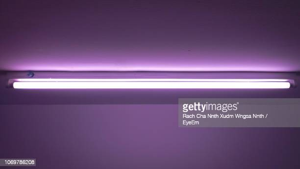 illuminated fluorescent light on ceiling - fluorescent light stock pictures, royalty-free photos & images