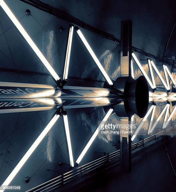 Illuminated Fluorescent Lights Against Wall At Subway Station