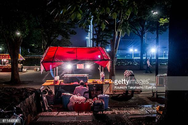 Illuminated Food Stall At Street