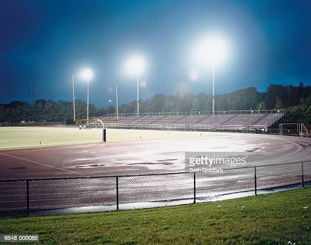 illuminated football field - sport venue stock pictures, royalty-free photos & images