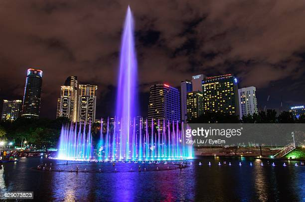 Illuminated Fountain At Klcc Park Against Sky In City At Night