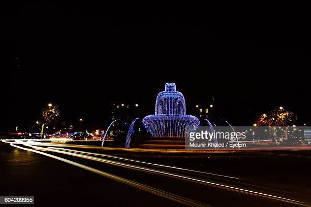 Illuminated Fountain In City During Christmas
