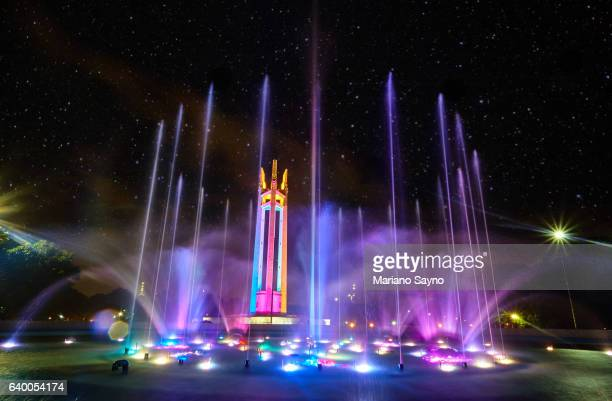 Illuminated Fountain In Park At Night