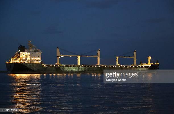 Illuminated Freight ship at dusk