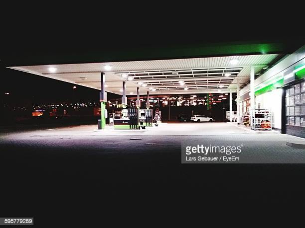 Illuminated Gas Station At Night