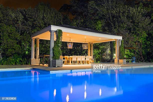 illuminated gazebo at poolside - gazebo stock pictures, royalty-free photos & images