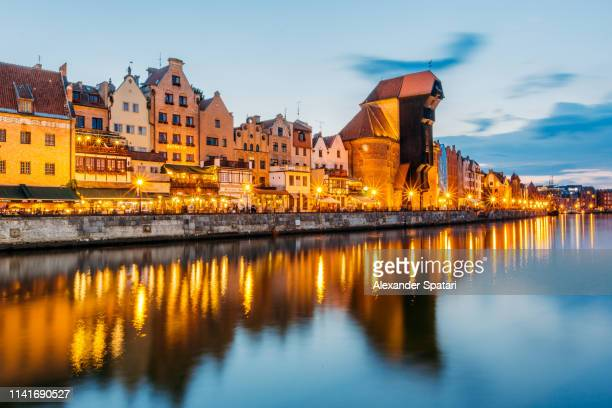 illuminated gdansk skyline after sunset, poland - gdansk stock pictures, royalty-free photos & images