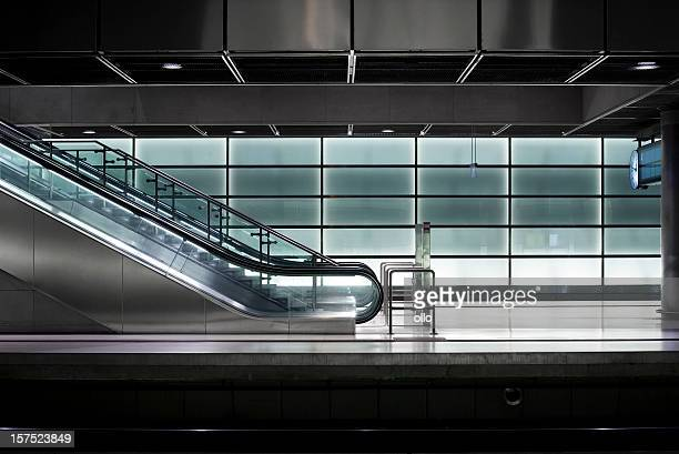 Illuminated glass wall - subway railway station
