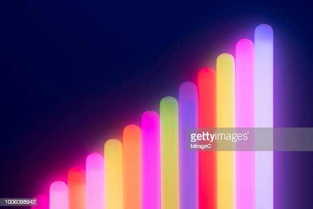 illuminated glow sticks bar graph - fluorescerende stockfoto's en -beelden