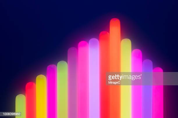 illuminated glow sticks bar graph - infographic stock pictures, royalty-free photos & images