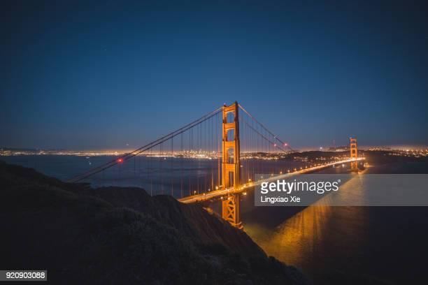 illuminated golden gate bridge with light trails at night, san francisco - san francisco california - fotografias e filmes do acervo