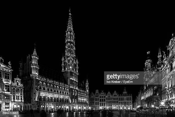 Illuminated Grand Place Against Sky At Night