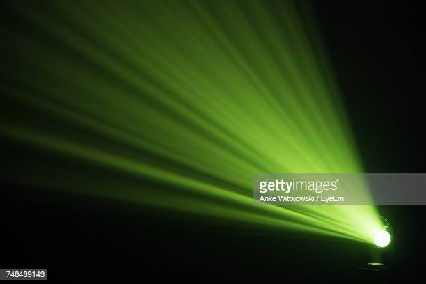 Illuminated Green Stage Light In Dark