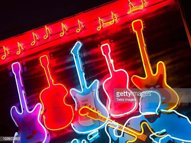 illuminated guitars on beale street in memphis - blues music stock pictures, royalty-free photos & images