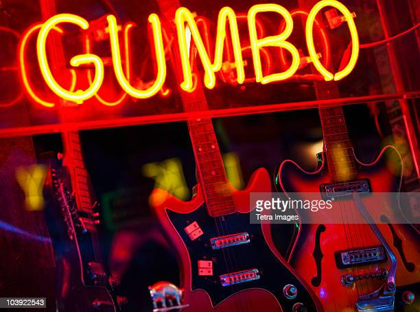 illuminated gumbo sign on beale street in memphis - beale street stock pictures, royalty-free photos & images