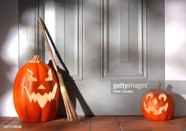 illuminated halloween pumpkins on doorstep - naughty halloween stock photos and pictures
