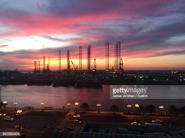 illuminated harbor against sky at sunset - emirate of sharjah stock pictures, royalty-free photos & images