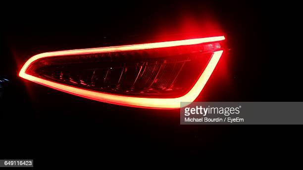Illuminated Headlight Of Car At Night