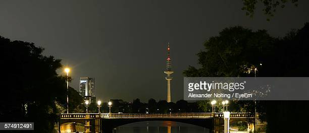 illuminated heinrich-hertz-turm tower by bridge against sky - hertz stock pictures, royalty-free photos & images