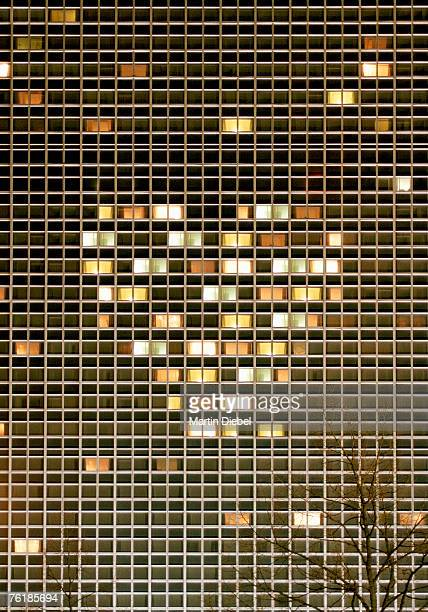 Illuminated high rise building with lights arranged in a heart shape