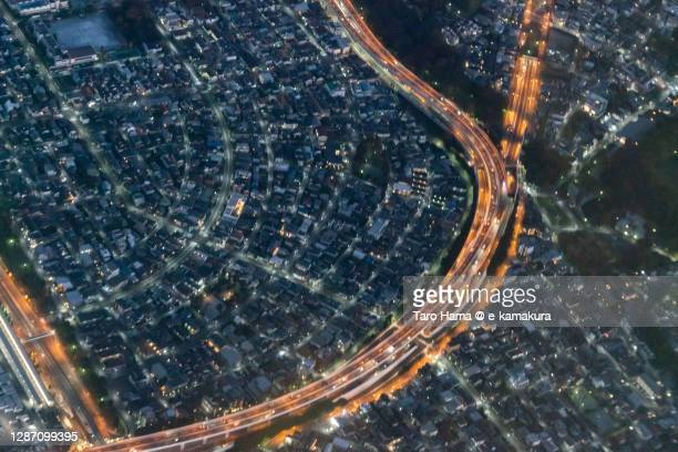 illuminated highway in tokyo of japan aerial view from airplane - taro hama ストックフォトと画像