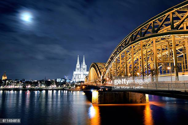 Illuminated Hohenzollern Bridge And Cologne Cathedral At Night