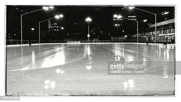 illuminated ice rink at night - ice rink stock photos and pictures