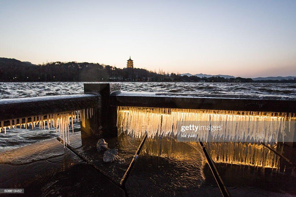 Illuminated icicles on bridge against the Leifeng Pagoda by the West Lake,Hangzhou,Zhejiang,China : Stock Photo