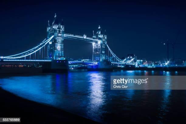Illuminated iconic bridge in cityscape at night, London, England, United Kingdom