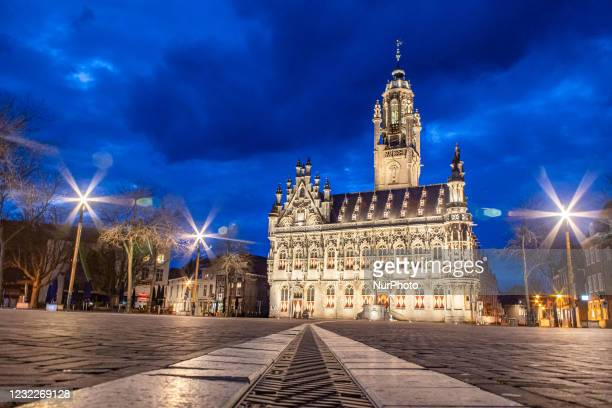 Illuminated iconic Middelburg Town Hall, one of the main monument attractions of the city sightseeing, a landmark of architecture as seen after the...