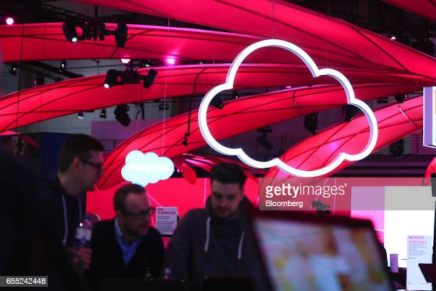 Illuminated icons representing the icloud hang from a hall ceiling at the CeBIT 2017 tech fair in Hannover Germany on Sunday March 19 2017 Leading...