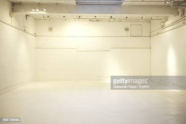 Illuminated Interior Of White Empty Room