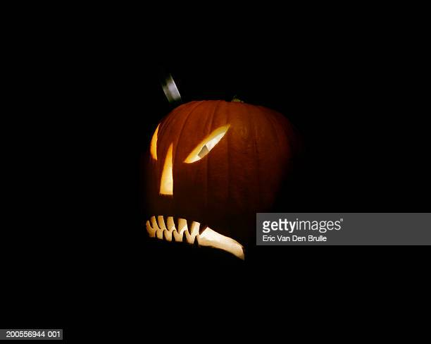 illuminated jack o' lantern on black background - eric van den brulle stock pictures, royalty-free photos & images