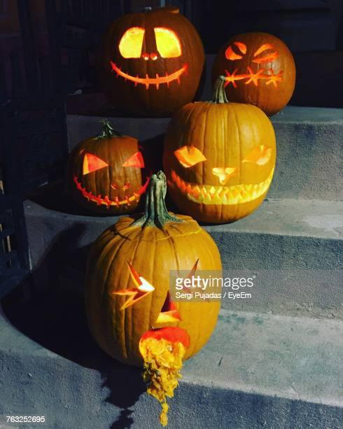 illuminated jack o lanterns on steps during halloween - scary pumpkin faces stock photos and pictures