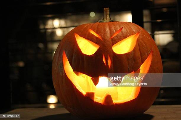 Illuminated Jack-O-Lantern On Table