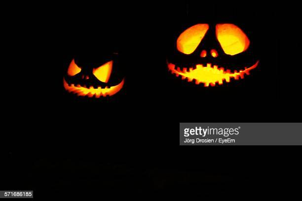 Illuminated Jack-O-Lanterns At Night
