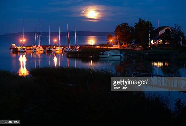 illuminated jetty at night - dalsland stock photos and pictures