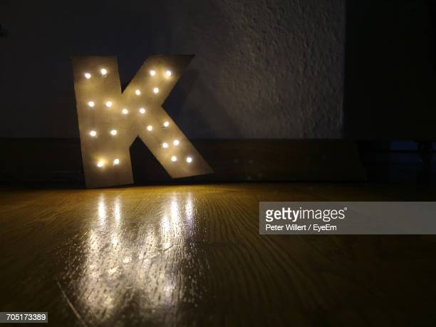 Illuminated K Letter In Darkroom