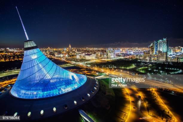 illuminated khan shatyr entertainment center at night, astana, kazakhstan - カザフスタン ストックフォトと画像
