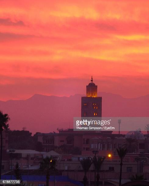 Illuminated Koutoubia Mosque And Buildings Against Cloudy Sky During Sunrise