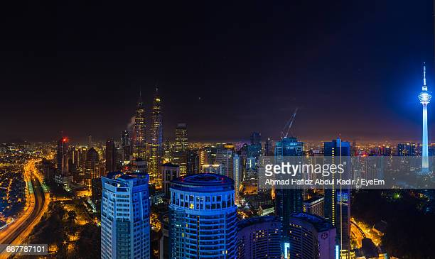 Illuminated Kuala Lumpur Tower With Cityscape Against Sky At Night