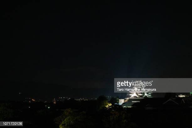 Illuminated Kumamoto Castle in Kumamoto city in Kumamoto prefecture in Japan