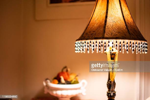 illuminated lamp at home - oleksandr vakulin stock pictures, royalty-free photos & images
