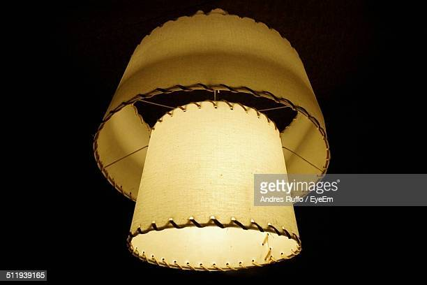 illuminated lantern against black background - andres ruffo stock photos and pictures