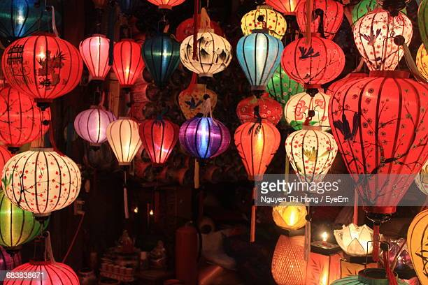 Illuminated Lanterns At Market During Night