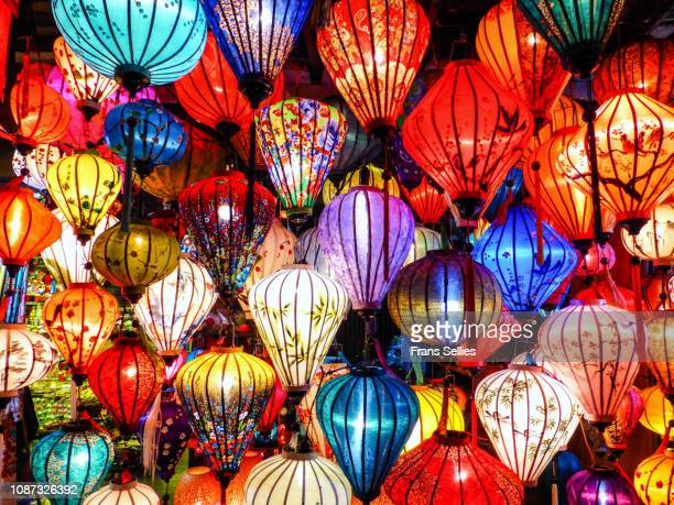 illuminated lanterns hanging at night in the old town of hoi an, vietnam - 中国提灯 ストックフォトと画像