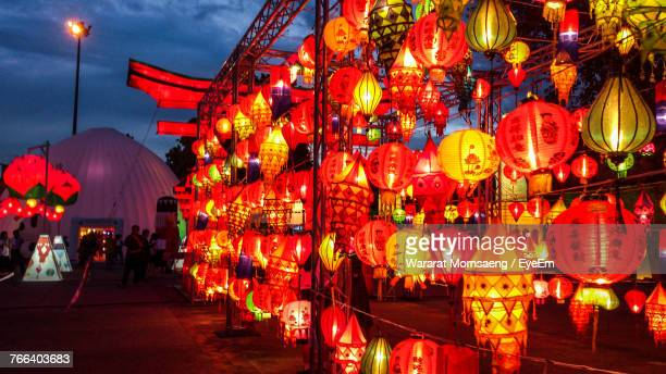 illuminated lanterns hanging for sale at night - lantern festival stock photos and pictures