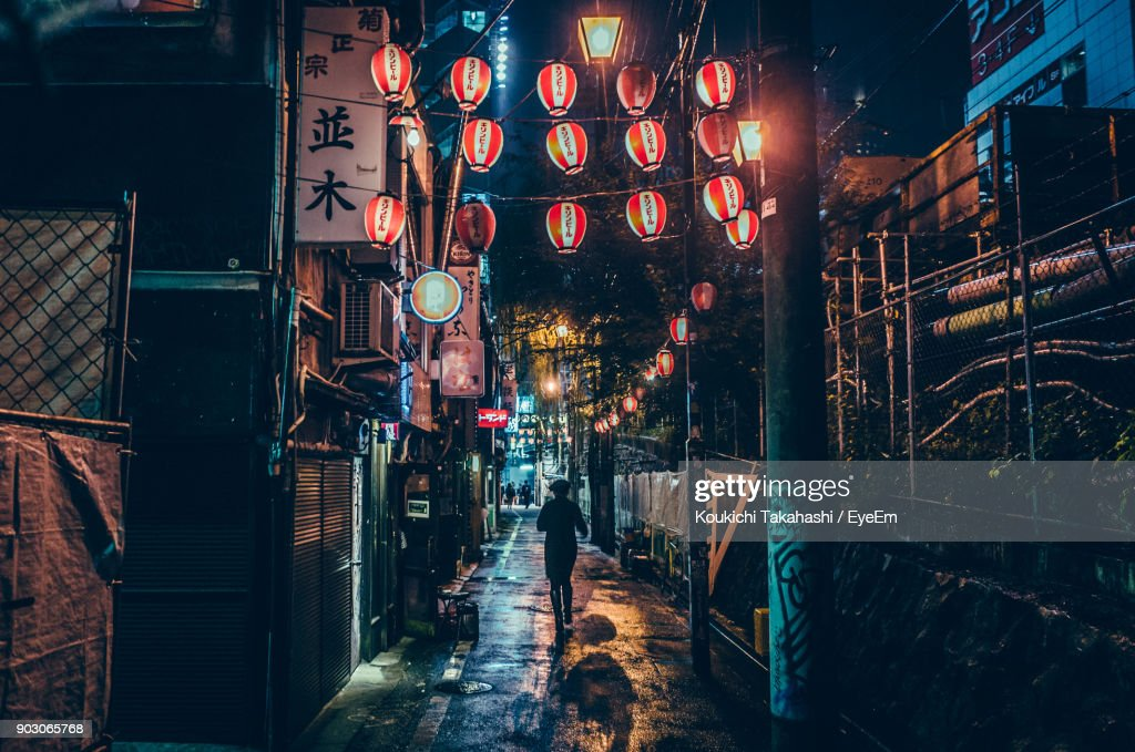 Illuminated Lanterns Hanging Over Street At Night : Stock Photo