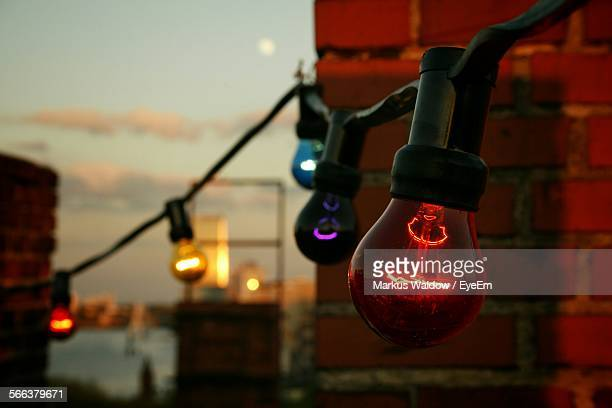 illuminated light bulbs at dusk - kreuzberg stock photos and pictures